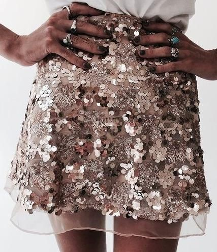 BLACK MODEL IN A SEQUINED SKIRT