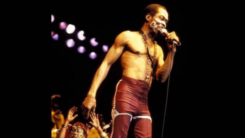FELA HOLDING A MICROPHONE AND SINGING