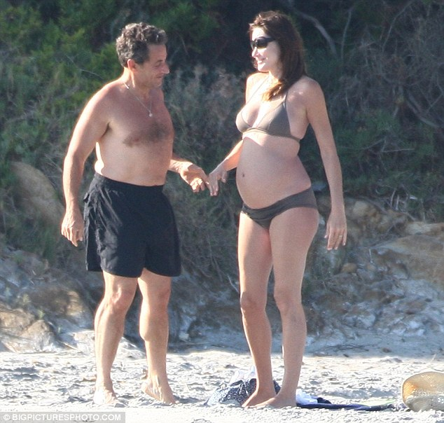 CARLA & HUSBAND NICHOLAS LOOKING AGT HER PREGNANT BELLY