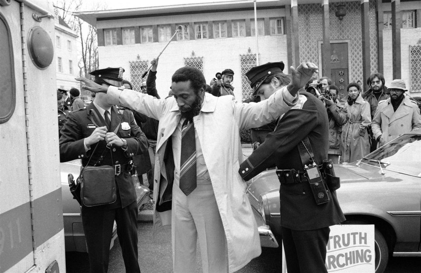 DICK GREGORY, BEING ARRESTED IN 1977 OUTSIDE THE SOUTH AFRICAN EMBASSEY IN WASHINGTON DCjpg