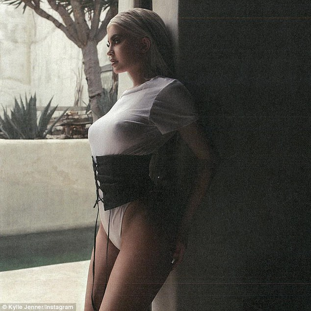 KYLIE JENNER IN A WHITE LEOTARD