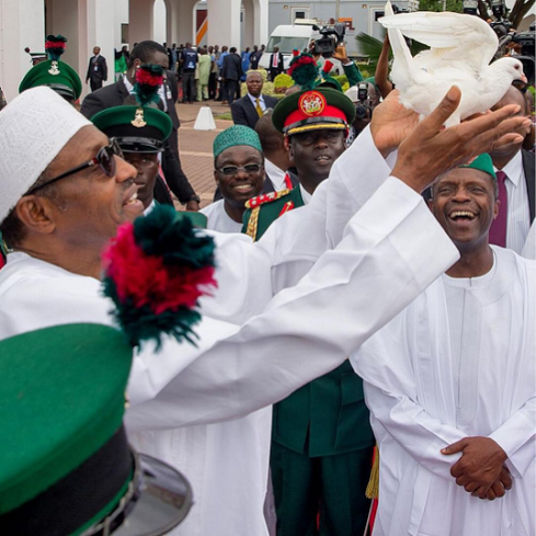 NIGERIAN PRESIDENT BUHARI IN ABUJA, RELEASES A WHITE DOVE, IN CELEBRATION OF NIGERIA`S 57TH YEAR OF INDEPENDENCE