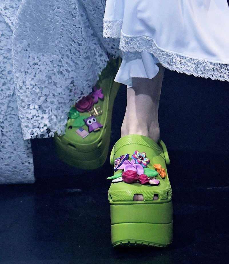 BALENCIAGA MODEL WEARING GREEN CROCS WITH ACCESSORIES .png.jpg