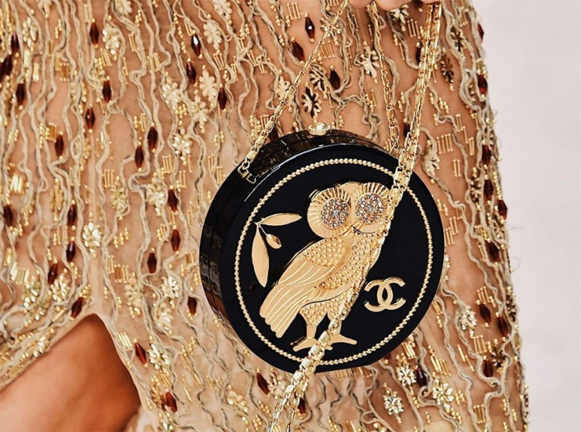 CHANEL SS18 MODEL WEARING A HEAVILY GOLD BEADED GOWN AND A CIRCLE HANDBAG FEATURING AN OWL – WITH THE INTERLOCKING Cs #2
