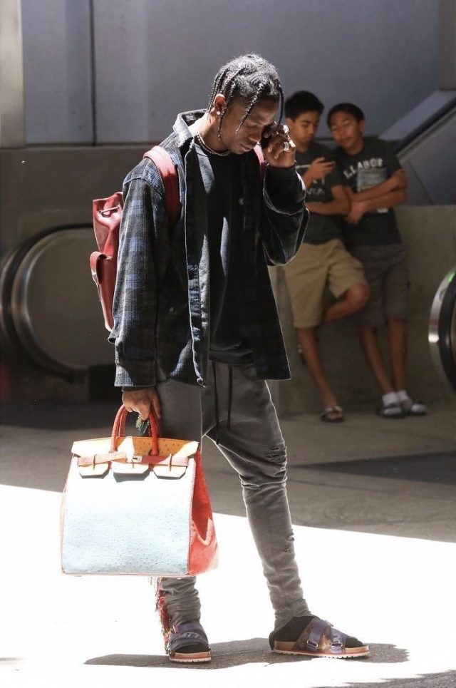 HERMES, TRAVIS SCOTT WEARING HERMES TRI - COLOR OSTRICH SKIN BAG