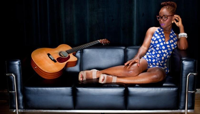 NIGERIAN FEMALE ARTIST BUKOLA ELEMIDE PUBLICITY SHOT IN POLKA DOTSjpg.png