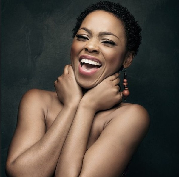 NIGERIAN FEMALE ARTIST CHIDINMA EKILE TOUCHING HER FACE