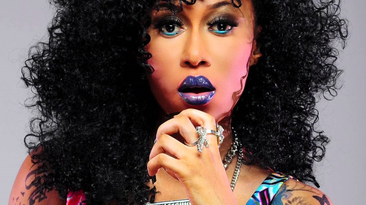 NIGERIAN FEMALE ARTIST CYNTHIA MORGAN WEARIN PURPLE LIPSTICK