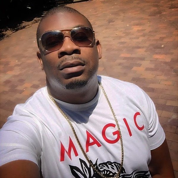 NIGERIAN MALE ARTIST DON JAZZY IN A WHITE SHIRT PHOTO.png