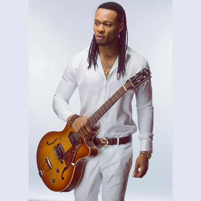 NIGERIAN MALE ARTISTS FLAVOUR WITH HIS GUITAR PHOTO.png