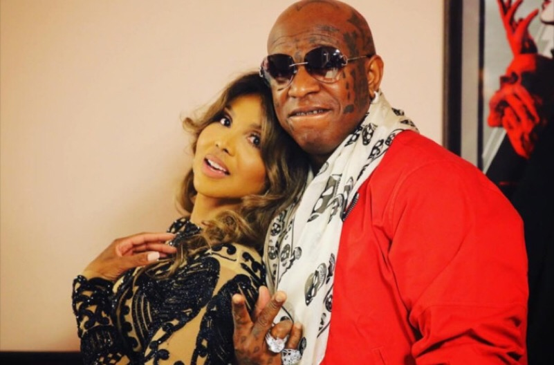 TONI BRAXTON AND BIRDMAN SMILING IN A RED JACKET#1.jpg