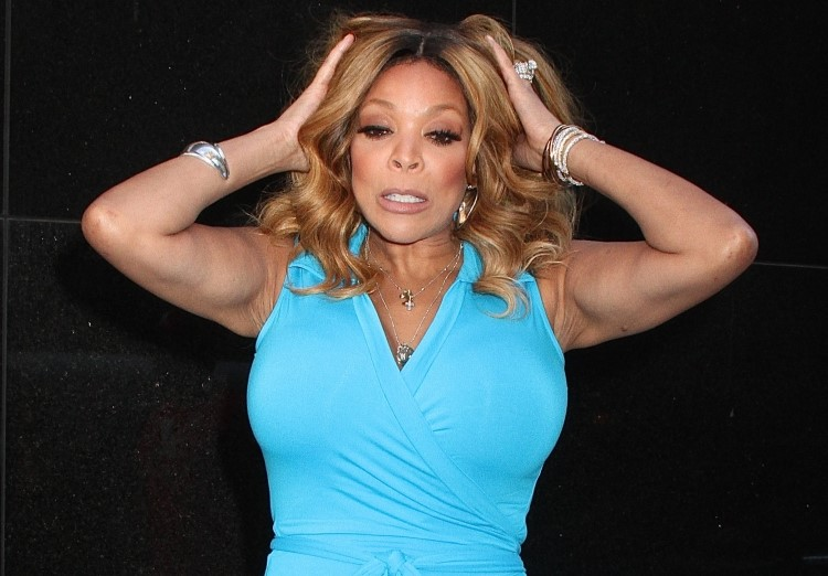 WENDY WILLIAMS CONFUSED IN A BLUE DRESS